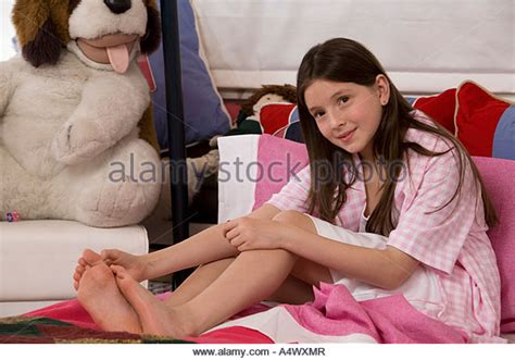 teen girl painted toenails girl painting toenail bed stock photos girl painting