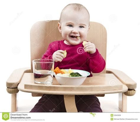 Baby In Chair by Child In High Chair Royalty Free Stock Images