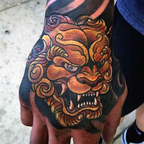 tattoo hand dog 100 foo dog tattoo designs for men chinese gaurdian lions