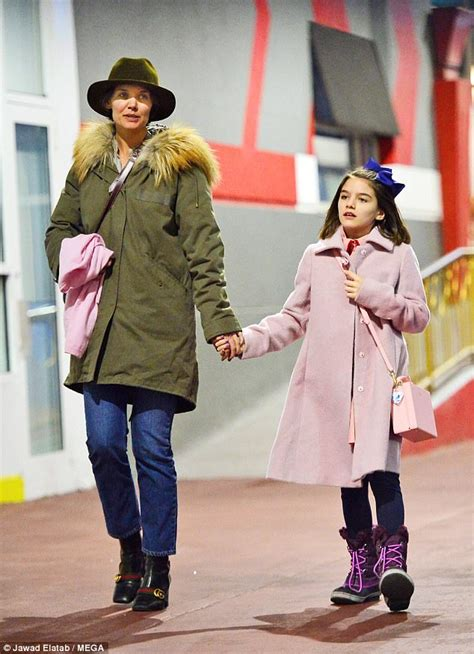Katie Holmes holds hands with daughter Suri walking in NYC