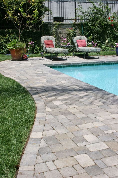 pool paver ideas pavers around a pool more expensive than poured concrete