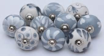grey and white ceramic knobs handpainted kitchen cabinet