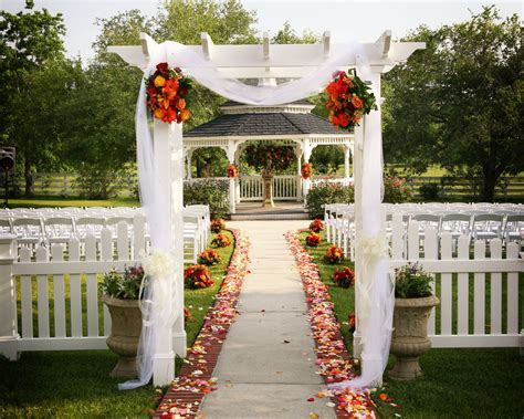 garden gazebo wedding ceremony aisle tulle flowers fabric