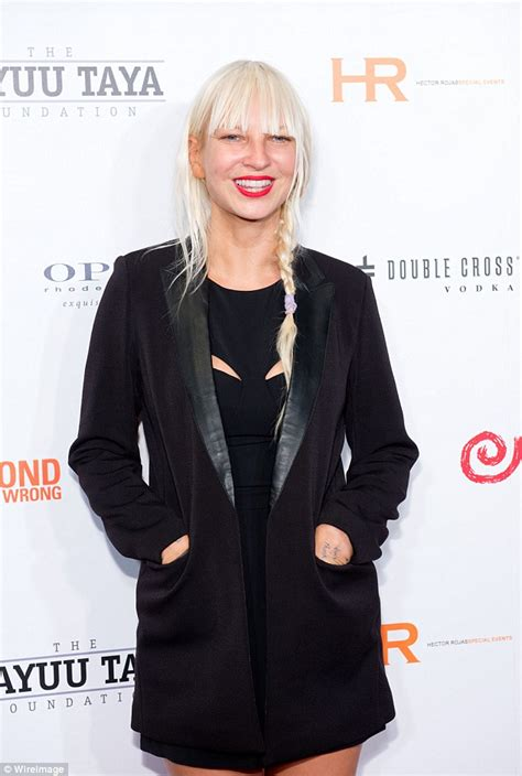 Girls White Chandelier Sia Hides Her Features Behind Famous Blonde Wig To Perform