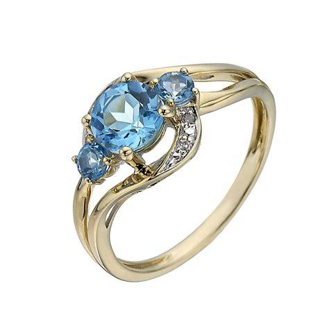 9ct yellow gold three blue topaz ring h