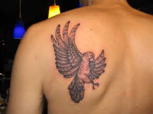 Left back shoulder flying hawk tattoo for men