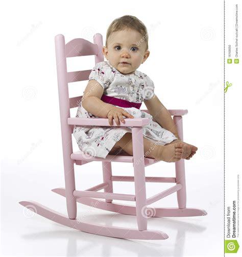 baby girl  rocking chair stock photo image