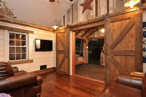 barn house doors 25 ingenious living rooms that showcase the beauty of sliding barn doors
