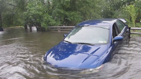 boat on fire driving down road heavy rain drenches long island flooding roads and