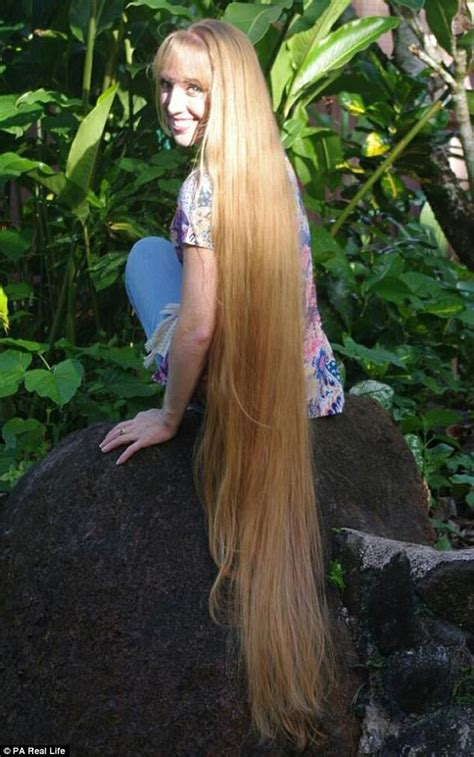 cut and inch hair real like rapunzel has 64 inch hair she refuses to get cut