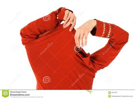 takes an orange shirt royalty free stock