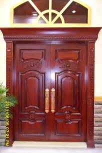 Kerala style carpenter works and designs main entrance wooden double