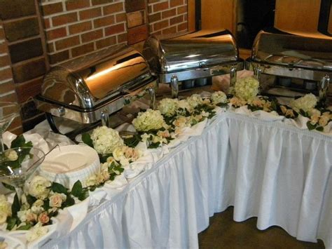 buffet tables decorated with beautiful flowers my
