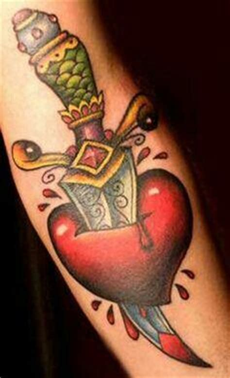 tattoo meaning heart dagger tattoo and piercings oh my on pinterest dagger tattoo