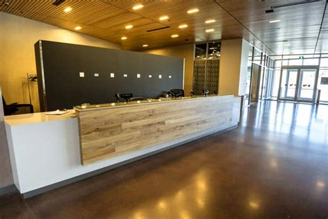 wood anchor public entrance reception desk canadian