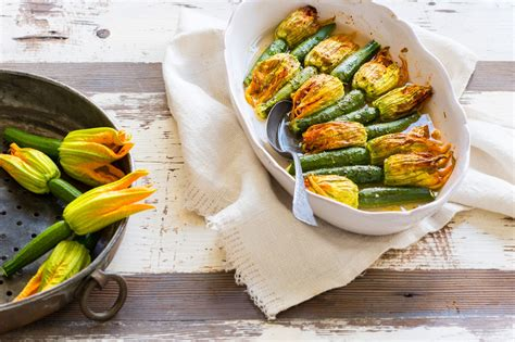 flower food recipe zucchini flowers stuffed with herbs and rice recipe sbs food