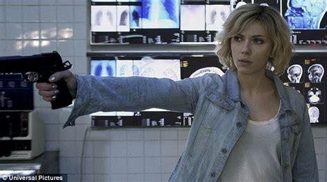 lucy film guns scarlett johansson stars in promo shots for new luc besson