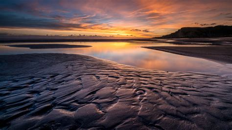 sunset red cloud wet ground mud reflection  water