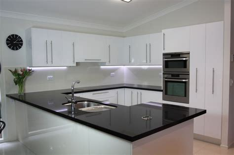 kitchens with black bench tops black benchtop white cupboards classic style that never