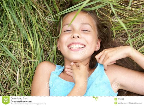 naughty preteens smiling girl lying on grass royalty free stock images