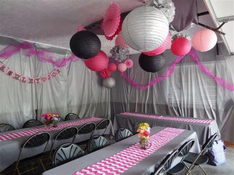 bridal shower  garage plastic tablecloths hung  walls