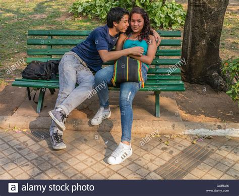 lovers on a park bench two lovers sitting on a park bench www pixshark com