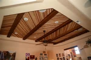 accenting a plank ceiling with beams faux wood workshop