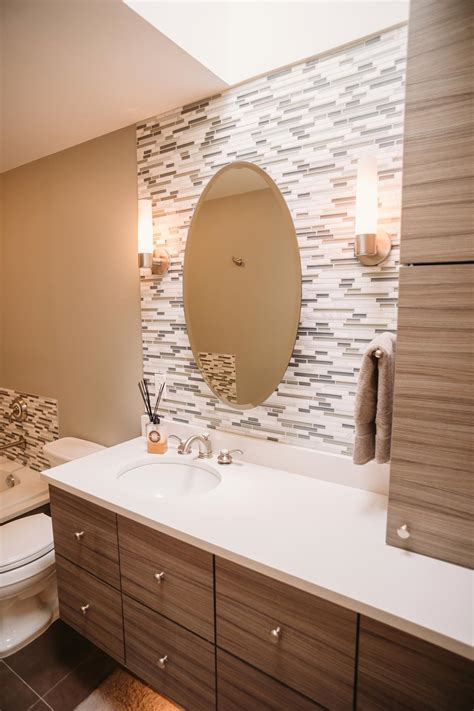gorgeous contemporary bathroom  glass tile accent wall