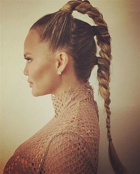 ponytail close braided style chrissy teigen s futuristic triple braided ponytail is the