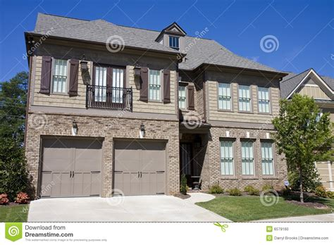 house with brick and siding brick and siding house under blue sky stock photo image 6579160