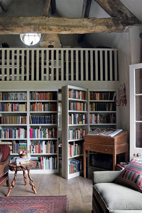 a stone cottage filled with books in the english countryside