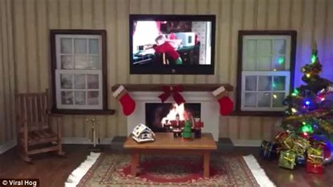 home alone christmas decorations video shows digital sweater with a fireplace and home