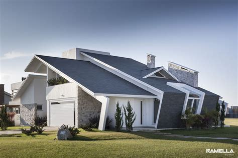 angled roof pitched roofline on house morphs into angled facade