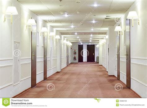 How To Get A Hotel Room For Free by Hallway With Many Doors Leading Into Hotel Rooms Stock