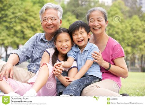 images of family chinese grandparents sitting with grandchildren stock
