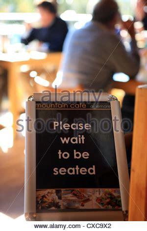 wait to be seated sign wait to be seated sign stock photo royalty free