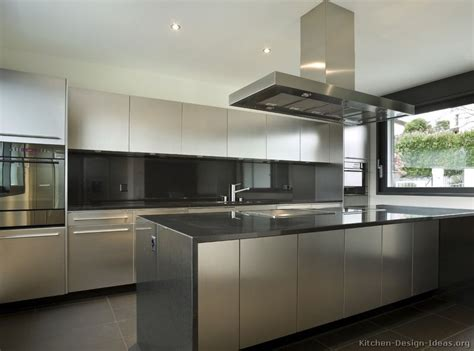 stainless steel kitchen cabinets with black granite