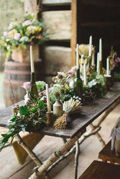 composizione con candele centrotavola con bottiglie per il matrimonio foto