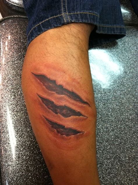 skin tear tattoo designs rip tattoos designs ideas and meaning tattoos for you