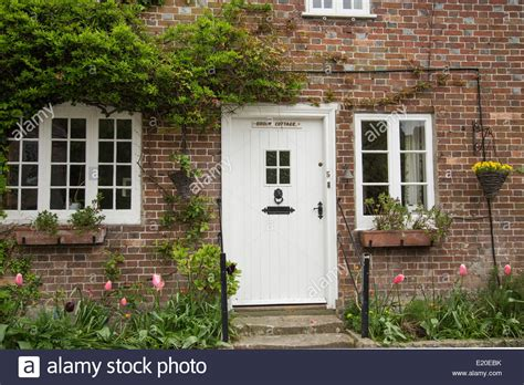up of traditional cottage with white front door in