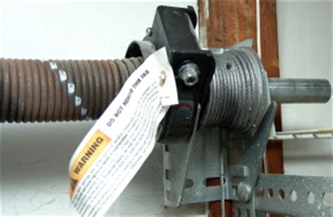How To Wind Garage Door Cables by How To Replace Garage Door Torsion Springs