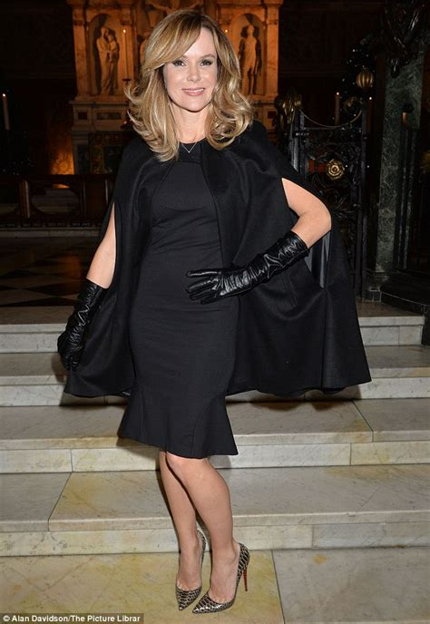 amanda holden hits a chic note in black cape and leather
