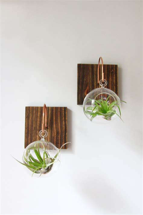 interesting wall decor set of two wood and copper wall mounts with glass orb and