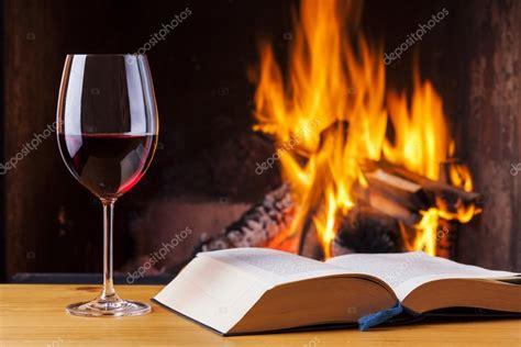 the evenings a winter s tale books wein und buch am kamin im winter stockfoto 66206131