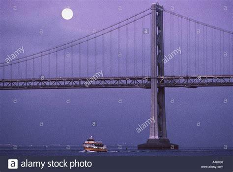 boats under san francisco california san francisco full moon stock photos