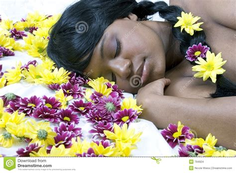 bed of flowers sleeping beauty in a bed of flowers stock photo image