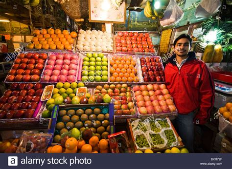 fruit vendor fruit vendor in an indoor market in kolkata india stock