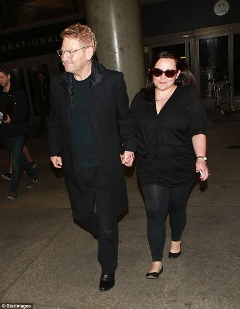 Kenneth Branagh leads wife Lindsay Brunnock by the hand at LAX airport   Daily Mail Online