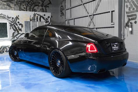 yellow rolls royce wraith murdered out rolls royce wraith keeps the party on the