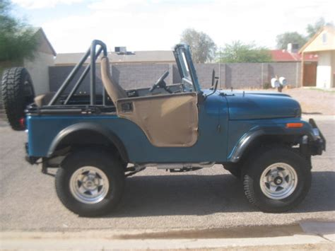 dark green jeep cj seller of classic cars 1971 jeep cj teal green tan and